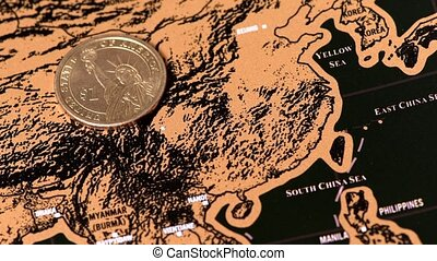 one dollar coin on black scratch travel map of China, Asia