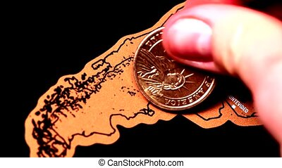 one dollar gold coin on blogger scratch travel map of Argentina