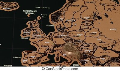 one dollar golden coin on black scratch travel map of Europe, EU