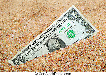 One dollar in the sand