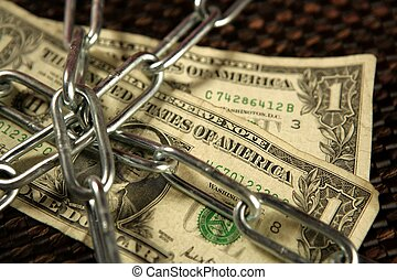 One Dollar notes in chains studio shot over brown background