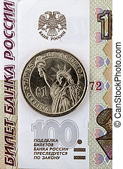 One dollar on a background of Russian money