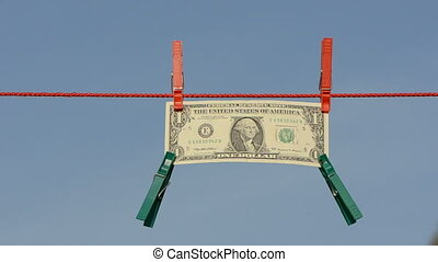 one dollar on clothes line