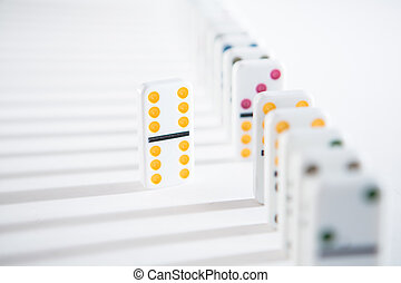 One domino standing separate to the line of dominoes with ...