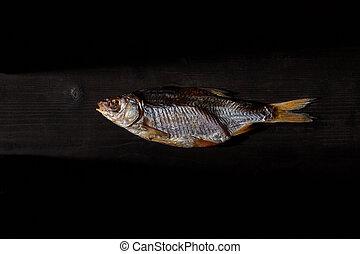 One dried or jerky salted taranka, yummy clipfish on wooden ...