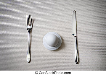 One egg with knife and fork