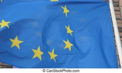 One EU flag, the emblem of European alliance, waving in...