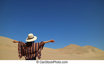 One female enjoy the awesome view of Huacachina desert in Ica region of Peru, South America