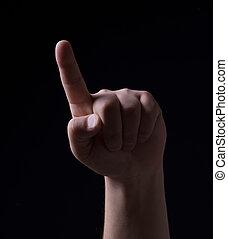 One finger on a black background