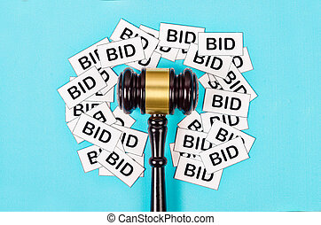 One gavel like those used on auctioning with the word bid.