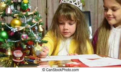 One girl draws a picture in the New Year's Eve, the other prevents it