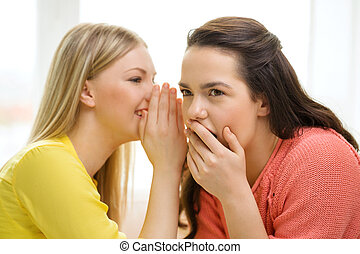 one girl telling another secret - friendship, gossip and...