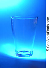 one glass on blue background