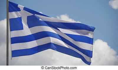 One Greek flag with a cross and stripes fluttering on a high...