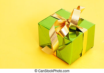 One green box on a yellow background