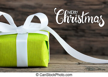 One Green Gift, White Bow, Wooden Background, Merry Christmas