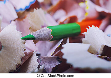 One green pencil and shavings