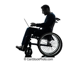 one handicapped man computing laptop computer in silhouette studio  on white background