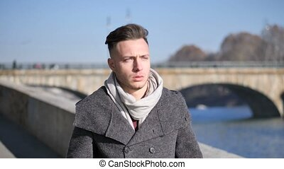 One handsome young man in urban setting in European city,...