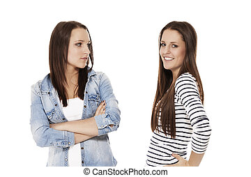 one happy and one upset teenager on white background