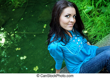 One happy beautiful young woman outdoors