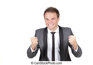 One happy energetic businessman with his arms raised.