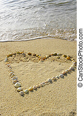 One heart in the sand with waves