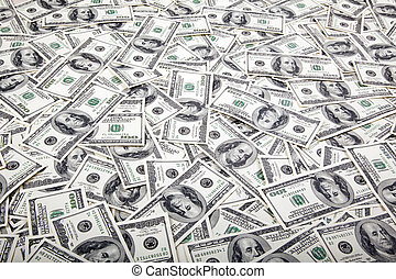 One Hundred Dollar Bills Background - Mess - A high angle...