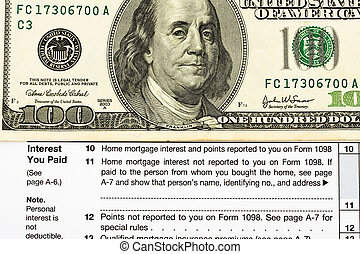 One hundred dollar bills sitting on tax papers, Federal Tax Forms for Items Deductions