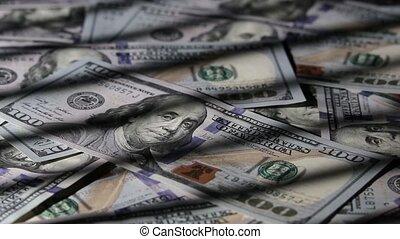 One hundred dollars banknotes macro. Rotation.
