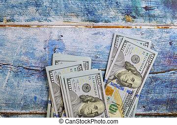 One hundred dollars on a blue background dollar bills.