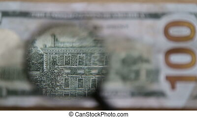 One hundred dollars,full hd video - Checking a bank note