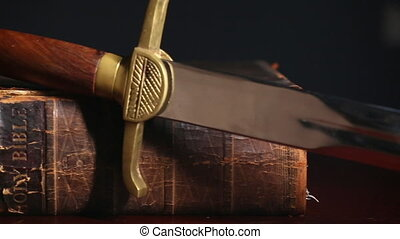 Ancient sword beside a 150 year old Bible