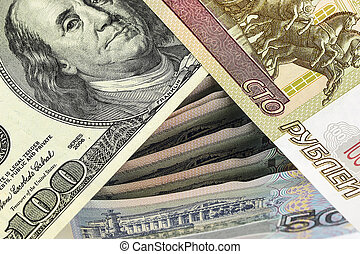 One hundred rubles, and a hundred dollars on Russian banknotes