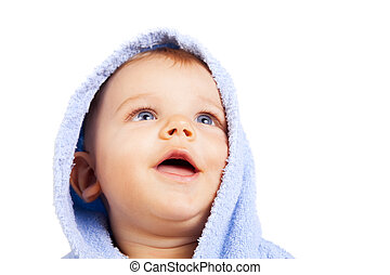 One isolated baby boy looking up - One isolated baby boy...