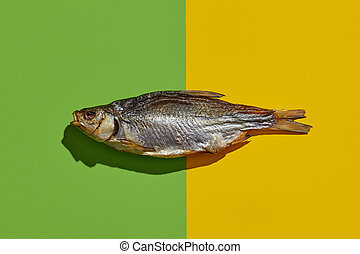 One jerky or dried salted roach, yummy clipfish on colorful ...