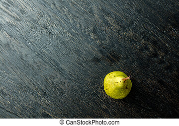 one juicy and ripe pear on a black background. View from...