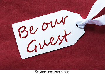 One Label On Red Background, Text Be Our Guest