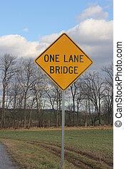 One Lane Bridge Sign - Yellow warning sign warning of one ...