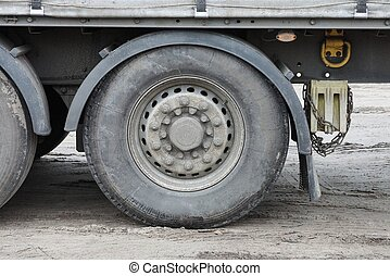 one large dirty wheel on a truck