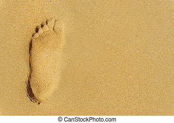 one large footprint on the sand with copyspace
