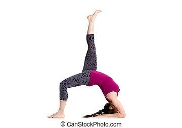 One legged Wheel pose - Sporty beautiful young woman doing...