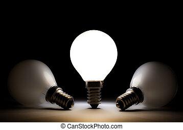 One light bulb with some dead bulbs