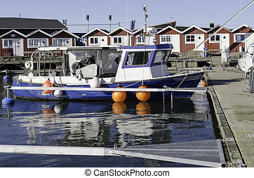 one little fishing boat in the harbour