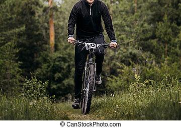 one male cyclist in black sportswear