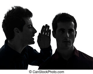 one man hearing voices gossip - two caucasian young men ...