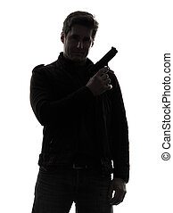 one man killer policeman holding gun portrait silhouette studio white background