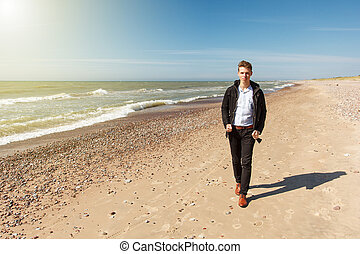 1187d4af198a Man woman couple walking on an empty beach. Romantic man and woman ...