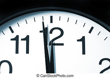 A macro shot of a clock with one minute left to 12.