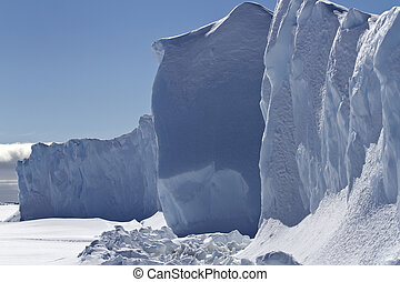 one of the sides of a small table iceberg frozen in Antarctic wa